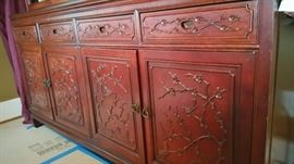 Carved detail on cabinet doors