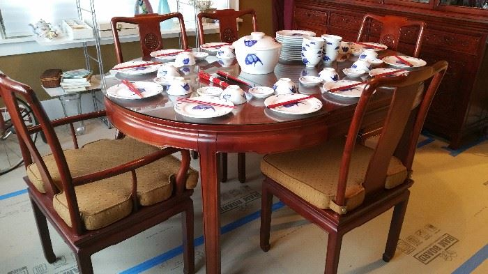 Asain motif dining room table and eight chairs