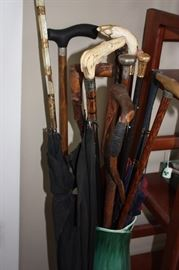 Collection of antique canes, some with 14K gold