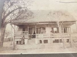 Original front view of the house with the Bertrand family
