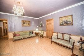 can you see the chandelier original to the house for sale?