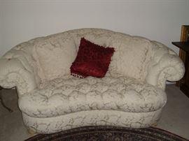 Cream love seat