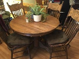 cute antique pedestal oak table with four early chairs