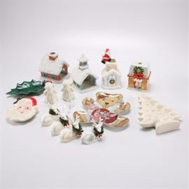 "Christmas Tableware and Decor: A selection of Christmas tableware and decor. There are assorted ceramic trays, reindeer napkin holders, angel shape shakers, and votive candle holders. Featured is a decorative porcelain teddy bear shape plate titled Tugging at my Heartstrings by the Franklin Mint, numbered ""HA7247."" Plates and trays are recommended for decorative purposes only and not known to be food safe."