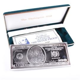 "2003 Fine Silver ""100 Dollar"" Proof Bullion Bar: A 2003 ""one hundred dollar bill"" bullion bar, struck in .999 fine silver. This bar was issued by the Washington Mint in 2003 and comes with a certificate of authenticity. The bar is inscribed "".999 Fine Silver"" and ""Series 2003."" The bar weighs 4.095 ozt and comes in a hard-shell display case."