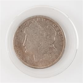 "1921-S Morgan Siver Dollar: A 1921-S silver dollar. This coin is marked ""S"" for the San Francisco mint and presents in an acrylic casing."