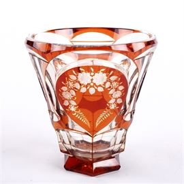 Amber Cut to Clear Czech Crystal Vase: An amber-cut-to-clear Czech crystal vase. This vase features a geometric base with a flared bowl. The vase features clear and amber glass decor with delicate etched floral detail. Vase does not feature maker's marks.