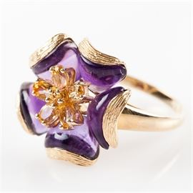 14K Yellow Gold, Citrine, and Amethyst Floral Statement Ring: A 14K yellow gold floral statement ring featuring citrine gemstones to the center framed by fantasy cut amethyst gemstones with a textured gold border.
