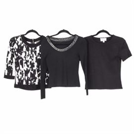 Women's Knit Tops Including Emanuel Ungaro: A group of women's knit tops including Emanuel Ungaro. The three tops in black tones include a short sleeve scoop neck tee shirt from Emanuel Ungaro, and a long sleeve scoop neck with leather trim from Osimo, Italy. The Vince Camuto black and white abstract print top, with back zipper closure, features black trim on the scoop neck, three quarter sleeves, and bottom hem.