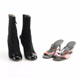 Kate Spade Boots and Heels: A small selection of Kate Spade shoes. The selection includes a pair of tall, black, suede booties with patent leather accents on the vamp and back of the heel with a small black bow on the back of the heel and a zipper on the sides. The booties are a size 7B. Also included is a pair of sandal heels with an open toe, no back, and multicolored striped straps. The sandal heels are a size 7.5B.