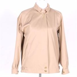 """Men's Burberry's Jacket: A men's Burberry's jacket. This tan jacket features a buttoned band at collar, zipper front, slash pocket, double buttoned waist with adjustable side straps and buttoned/pleated cuffs. The interior is lined with Burberry's plaid fabric and is labeled """"Burberry Made in England""""."""