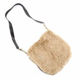 """Juicy Couture Rabbit Fur Purse: A Juicy Couture purse made of rabbit fur. The purse has a black leather crossbody strap with gold tone chains, leather framing, and gold tone zippers and hooks for the strap. The leather key ring reads """"I am the fairest"""" and the interior has other things printed on it like """"Shop!"""" and """"Juicy Kiss!!""""."""