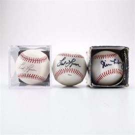 Autographed Baseballs: An assortment of autographed baseballs. This assortment of three autographed baseballs features a baseball with the Boston Red Sox logo signed by Jim Leyritz. Additional items include two baseballs signed by Fred Lynn.