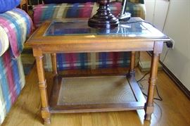 End table with glass top measures 22x27.