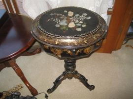 Victorian paper mache' accent table is good condition
