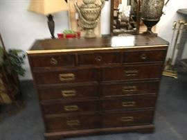 Chest of drawers with brass handles