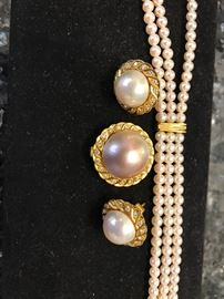 Mujoharat Al-Sharo, 3-strand cultured pearl necklace in gold,  and diamonds.  Matching earrings and pendant