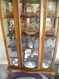 Antique display cabinet with LOTS of pink depression glass!