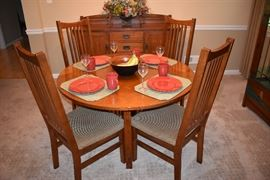 Mission style oak round dining table with 4 oak chairs in the Stickley motif