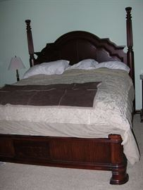 King bed with padded leather headboard