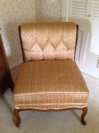 One of two matching bedroom chairs