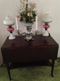 Drop leaf antique 2-tiered cart; matching white & cranberry lamps; candelabra epergne