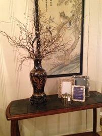 Black Asian vase; silver frames