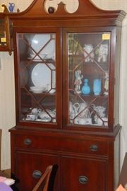 Mahogany or Cherry china cabinet matches the buffet,  dining table and six chairs. Elegance is yours for bargain prices.