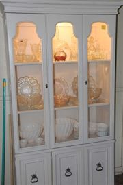 Painted white, lighted China cabinet features American pressed glass and Milk Glass.