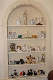 Porcelain dogs, cats and more, including a nice pair of Van Briggle kittens.