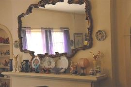 Large Mantel mirror is one of several in the home.