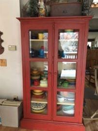 Red Curio Cabinet with modern Fiesta Ware