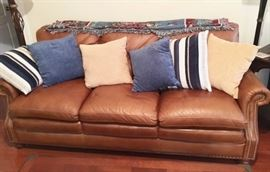 Leather sofa in better lighting, with pillows