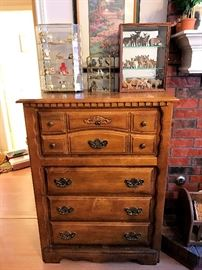 Great chest of drawers with miniatures in display cabinets