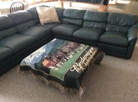 Leather Sectional Sofa, far end section is recliner. Also has matching ottoman.