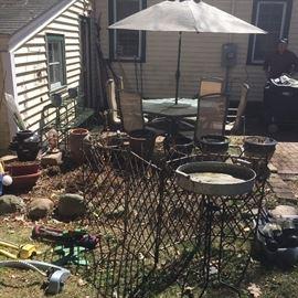 Lots of garden pots, plant stands, bird feeders etc