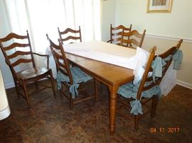 Beautiful Wooden table and chair set. Includes 6 chairs.