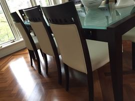 Contemporary 9 Piece Dining Room Set-  Seats are covered in faux leather and wood is in the color of espresso.