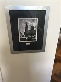 A triple series of photographs in a brushed aluminum frame. From Stickley Audi