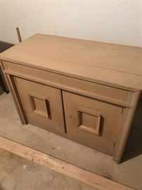 CABINET THAT TURNS INTO LONG TABLE