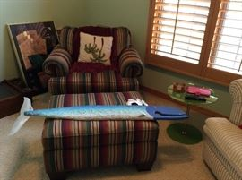 Striped overstuffed chair with matching ottoman