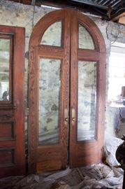 Arched doors with beveled glass