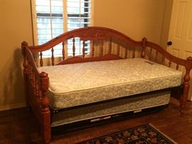 Very nice wood day bed with pop up trundle. Includes mattresses.