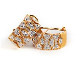 18K Yellow Gold Diamond Earrings: A pair of 18K yellow gold diamond earrings.