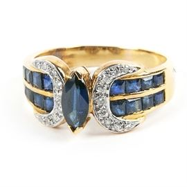 14K Yellow Gold Diamond and Sapphire Ring: A 14K yellow gold 0.10 ctw diamond and sapphire ring.