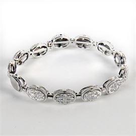 18K White Gold Diamond Cuff Bracelet: An 18K white gold 0.90 ctw diamond cuff bracelet.