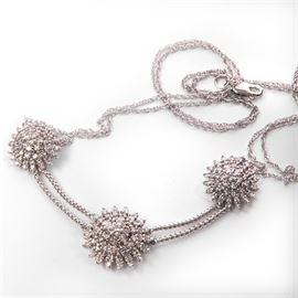 14K White Gold 1.57 CTW Diamond Necklace: A 14K white gold 1.57 ctw diamond necklace.