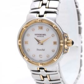 Raymond Weil Parsifal Diamond Wristwatch: A stainless steel Raymond Weil Parsifal diamond wristwatch. This wristwatch features a stainless steel case and bracelet links with gold wash accents. The face features eight bezel set diamonds arranged in a circular fashion.