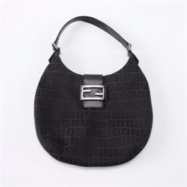 Vintage Fendi Black Canvas Handbag: A vintage Fendi black canvas handbag. This vintage handbag from Fendi features a magnetic metal branded clasp with a black leather shoulder strap and black jacquard Fendi fabric. The silver-tone hardware is marked Fendi.