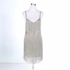 Kate Moss Topshop Beaded Flapper Style Dress: A Kate Moss Topshop beaded flapper style dress. This spaghetti strap dress features two rows of silver-tone and iridescent beaded fringe, nude colored liner, a zippered back closure, and the original manufacturer's tags. The dress was made in India.